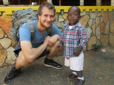 Ryan Hreljac meets a young boy in the community where a well will soon be constructed providing the community with clean water